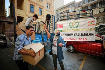 Turkish volunteers distribute food and water at the site of this week's massive explosion in the port of Beirut, Lebanon, August 8, 2020.
