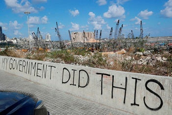 A picture taken on August 9, 2020, shows graffiti on the wall of a bridge overlooking the port of Beirut.
