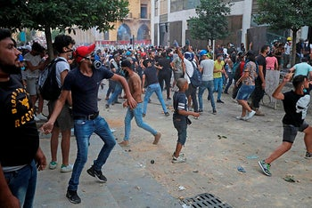 Lebanese protesters, enraged by a deadly explosion blamed on officials' negligence, clash with security force, Beirut, August 9, 2020.