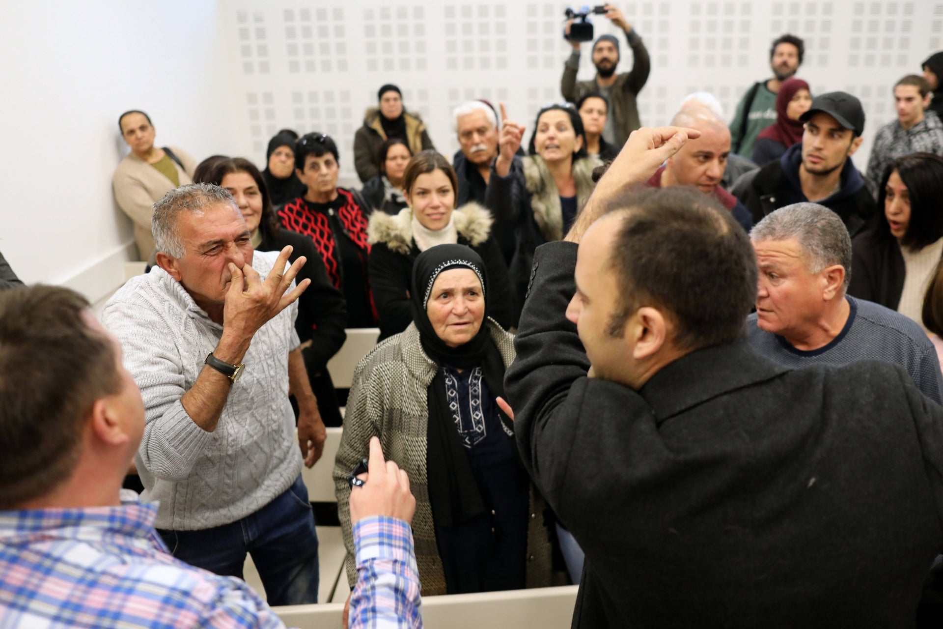 Members of Bakri's family confront IDF reservists in court.