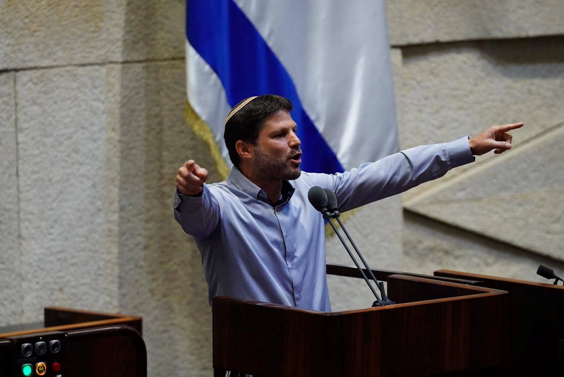 Smotrich speaking from the Knesset podium during a debate on a bill to circumvent the High Court of Justice.
