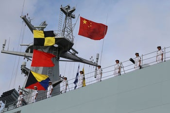 Soldiers of China's People's Liberation Army (PLA) stand on a ship sailing off to set up a base in Djibouti, from a military port in Zhanjiang, Guangdong province, China July 11, 2017.
