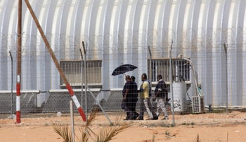 An inmate leaves the Holot detention facility as it is shut down, December 2018.