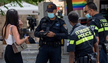 Police enforce coronavirus regulations in Jerusalem, June 2020.
