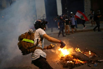 A demonstrator takes part in anti-government protests that have been ignited by a massive explosion in Beirut, Lebanon August 10, 2020.