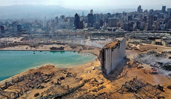 An aerial view shows the massive damage done to Beirut port's grain silos and the area around it on August 5, 2020, one day after a mega-blast tore through the city's port.