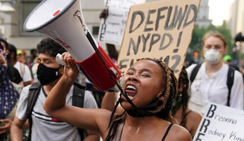 People protesting near city hall calling for the New York City government to defund the police, June 30, 2020.