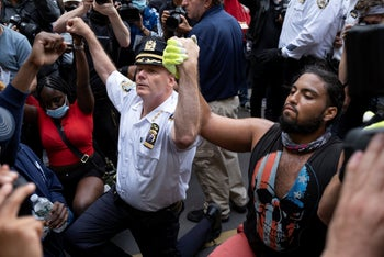 Terence Monahan, the NYPD chief of department, taking a knee with protesters in New York, Monday, June 1, 2020.
