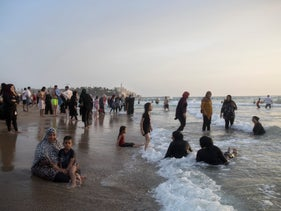 Palestinians at the beach in Tel Aviv, August 3, 3030