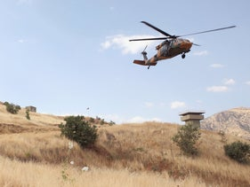 A Turkish battle helicopter at the border with Iraq, in Hakkari province, Turkey, June 19, 2020.