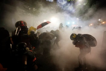 Federal officers launch tear gas at demonstrators during a Black Lives Matter protest at the U.S. Courthouse in Portland, Oregon. July 26, 2020