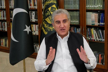 Pakistan's Foreign Minister Shah Mehmood Qureshi gestures as he speaks during an interview with Reuters at the Ministry of Foreign Affairs (MOFA) office in Islamabad, Pakistan June 25, 2020