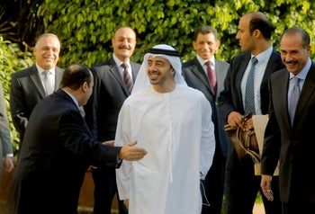 UAE Foreign Minister Sheikh Abdullah bin Zayed Al Nahyan, center, arrives at a meeting with Arab foreign ministers in Cairo, Egypt, December 21, 2013.