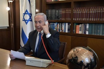 Prime Minister Benjamin Netanyahu on a phone call with Washington and Dubai, August 13, 2020.