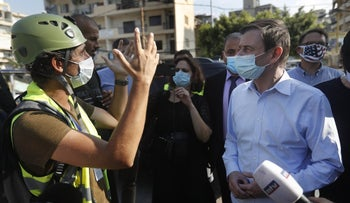 U.S. Undersecretary of State for Political Affairs David Hale, right, listens to an NGO volunteer during his visit to a main gathering point for volunteers, near the site of last week's explosion that hit the seaport of Beirut, Lebanon, August 13, 2020.