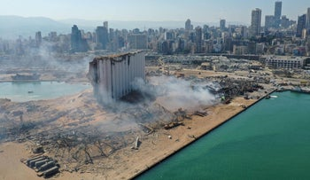 An aerial view shows the massive damage done to Beirut port's grain silos (C) and the area around it on August 5, 2020.