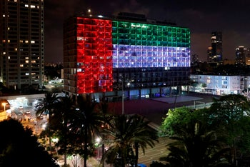 Tel Aviv city hall is lit up in the colors of the United Arab Emirates national flag to mark the dramatic announcement regarding bilateral relations and normalization, August 13, 2020.