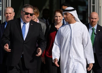 U.S. Secretary of State Mike Pompeo speaks with the Emirati Ambassador to the US Yousef Al Otaiba in Abu Dhabi, January 13, 2019.