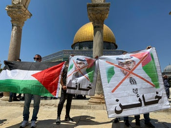 Palestinians protest the UAE's agreement with Israel in Jerusalem, August 14, 2020.