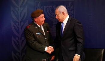 Former Israeli army Chief of Staff Gadi Eisenkot shaking hands with Netanyahu, April 6, 2019