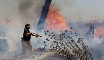 A firefighter in southern Israel, August 13, 2020.