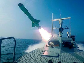 In this photo released on July 28, 2020, a Revolutionary Guard's speed boat fires a missile during a military exercise.