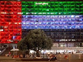 Tel Aviv City Hall lit up with the flag of the United Arab Emirates, as the UAE and Israel announced they would be establishing full diplomatic ties, in Tel Aviv, Israel, August 13, 2020.