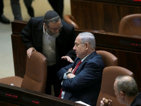 Lawmaker Moshe Gafni, from United Torah Judaism, speaks to Prime Minister Benjamin Netanyahu, at the Knesset, Jerusalem, August 1, 2018.