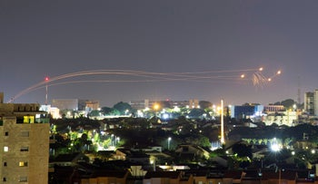 Iron Dome anti-missile system fires interception missiles as rockets are launched from Gaza towards Israel, as seen from the city of Ashkelon, Israel, August 16, 2020.