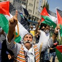 Palestinians take part in a protest against the United Arab Emirates' deal with Israel to normalize relations, in Nablus, West Bank, August 14, 2020.