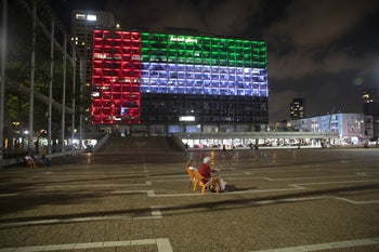 Tel Aviv city hall lit up in the colors of the UAE flag.