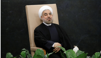 Iran's President Hassan Rohani waits to address the 68th United Nations General Assembly at UN headquarters in New York, September 24, 2013.