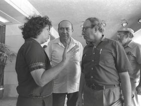 Gershon Shafat, center, talking with fellow Tehiya party members Geula Cohen and Yuval Ne'eman in the Knesset in 1984.
