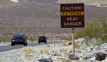 A sign warns of extreme heat as tourists enter Death Valley National Park in California June 29, 2013