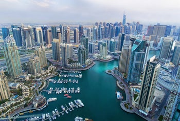 View on Dubai Marina skyscrapers and the superyacht marina, Dubai, United Arab Emirates, 2019.