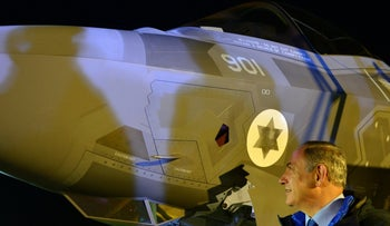 Israeli Prime Minister Benjamin Netanyahu next to a F-35 fighter jet just after it arrived in Israel from the U.S.
