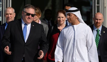 US Secretary of State Mike Pompeo, left, speaks with the Emirati Ambassador to the US Yousef Al Otaiba at the NYU Abu Dhabi campus in Abu Dhabi on January 13, 2019.