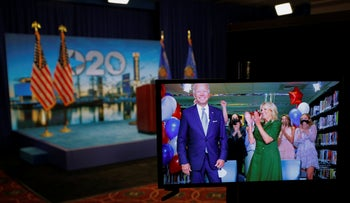 Joe Biden and his wife Jill react on a video feed after winning the votes to become the Democratic Party's 2020 nominee for President, during the DNC, August 18, 2020.