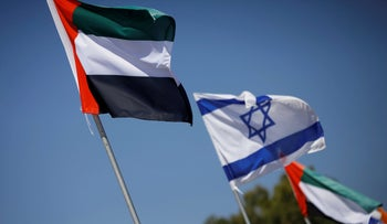 Israeli and UAE flags fly in Netanya, August 16, 2020.