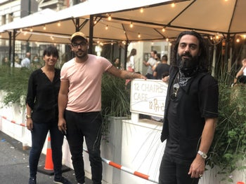Sammy Shamaev, right, with co-workers outside 12 Chairs Cafe in SoHo, New York.