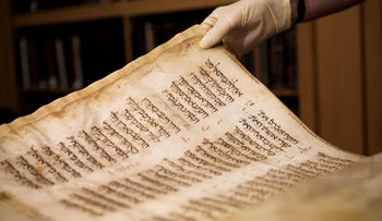 A library clerk shows a Jewish manuscript smuggled into Israel from Damascus in a spy operation by the Mossad in the early 1990s in Jerusalem, October 5, 2011.
