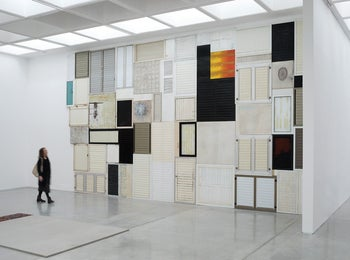 "Tsibi Geva's wall of shutters in the Israel Museum's 2020 exhibition ""Shutters and Stairs: Elements of Modern Architecture in Contemporary Art."""