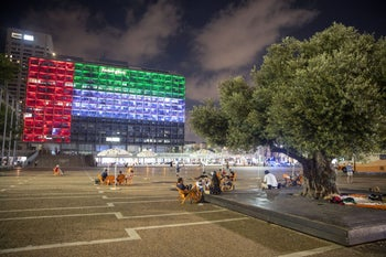 Tel Aviv City Hall is lit up with the flags of the United Arab Emirates and Israel as the countries announced they would be establishing full diplomatic ties, in Tel Aviv, August 13, 2020.