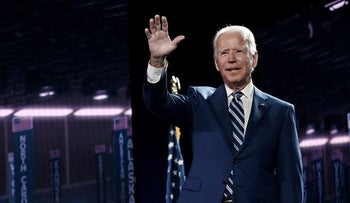 Biden waves on stage at the end of the third day of the Democratic National Convention, being held virtually amid the pandemic, at the Chase Center in Wilmington, Delaware on August 19, 2020.