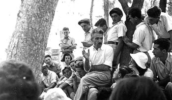 Meir Yaari, founder of the Bitania commune in the Galilee, surrounded by young acolytes.