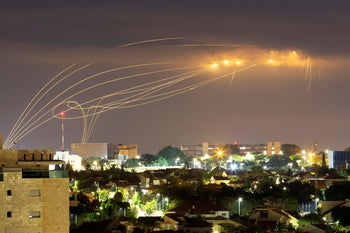 The Iron Dome anti-missile system fires interception missiles as rockets are launched from Gaza towards Israel, as seen from the city of Ashkelon, August 21, 2020.