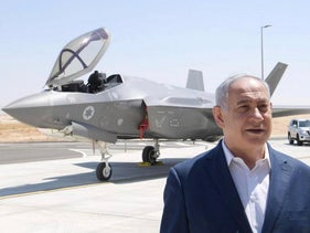 Netanyahu standing in front of an F-35 fighter jet in 2019