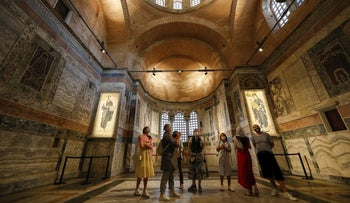 People visit St Savior in Chora church, known as Kariye in Turkish, in Istanbul, August 21, 2020.