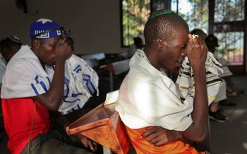 Young Ugandan jews make prayers at the new Stern Synagogue in Mbale, eastern Uganda in 2016.