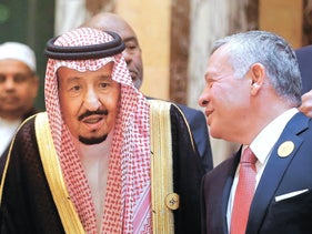 Jordan's King Abdullah II, right, talks to Saudi King Salman in Mecca, Saudi Arabia, June 1, 2019.
